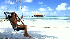 Beautiful and sexy woman resting at Maldives seaside Stock Footage