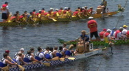 Stock Video Footage of Dragon Boats Docking After A Race