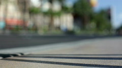 Shadow on side walk with cars going by Stock Footage
