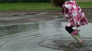 Stock Video Footage of Puddle Jumping - Little girl frog hops