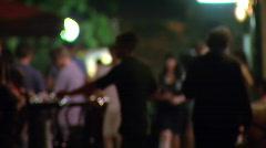 People walking on the street et night - defocused Stock Footage