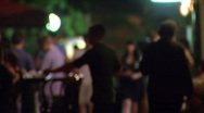 People walking on the street et night - defocused Stock Footage