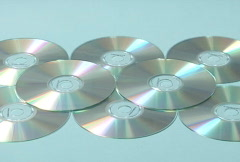 MP3 player lands on cds - slow motion Stock Footage