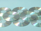 Stock Video Footage of MP3 player lands on cds - slow motion