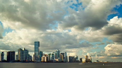 Puffy clouds over Miami sky line Stock Footage