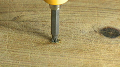 Unscrewing screw in wood  Stock Footage