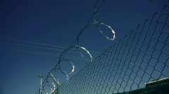 T183 barbed wire sharp prison fence Stock Footage