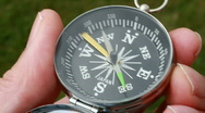 Stock Video Footage of Holding a magnetic directional compass