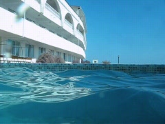 Camera moving on water surface in outdoor swimming pool Stock Footage
