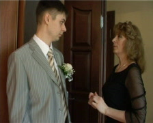 Happy mother considers her son a suit Stock Footage