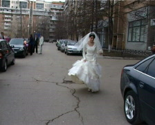 Bride in white dress comes on street of city Stock Footage