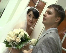 bridegroom with bride holding wedding bunch of flowers - stock footage