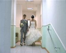 bridegroom and bride walks along the corridor - stock footage