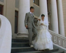 Groom and bride comes down the stairs Stock Footage