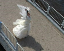 Bride in wedding gown rotates on bridge Stock Footage