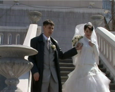 bridegroom holds hand bride and leads her down the stairs - stock footage