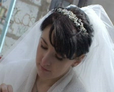 Bride touching wedding bouquet outdoors Stock Footage
