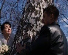 Bride and groom stands near church Stock Footage