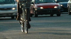 CU cyclist rides beside busy traffic - stock footage