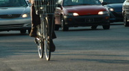 Stock Video Footage of CU cyclist rides beside busy traffic