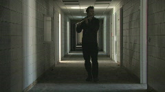 Flutist playing in dark hall. Stock Footage