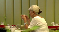 Old lady in a coffee house Stock Footage