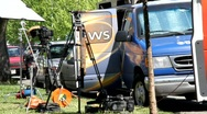 Stock Video Footage of TV News ENG Trucks
