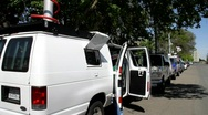 Stock Video Footage of TV news vans at crime scene