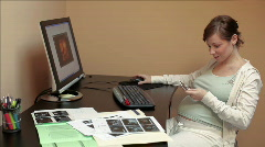 Pregnant woman looking at scans Stock Footage