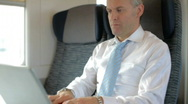 Stock Video Footage of Businessman working with laptop computer on train