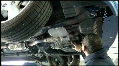 auto mechanic repairing car - stock footage