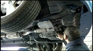 Stock Video Footage of auto mechanic repairing car