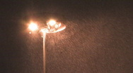 Highway lights in snowstorm. 2 shots. Stock Footage