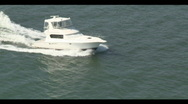 Stock Video Footage of Aerial Sport Fish Boat Underway Close Forward