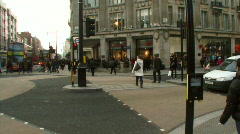 Commuters crossing Oxford Circus, London, UK Stock Footage