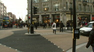 Stock Video Footage of Commuters crossing Oxford Circus, London, UK