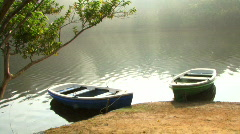 Boat in lake covered in fog, Neyyar Wildlife sanctuary, Kerala,India Stock Footage