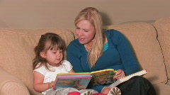 Mother & Daughter Reading a Book - stock footage