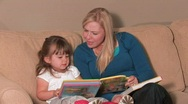 Mother & Daughter Reading a Book Stock Footage