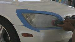 Headlight refinishing - 3 - various steps of ultra fine sanding and polish Stock Footage