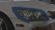 Stock Video Footage of Headlight refinishing - 1 - apply de-yellow UV spray