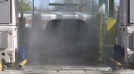 At the automatic car wash - 5 - zoom out front view of car being sprayed Stock Footage