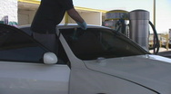 Windshield repair or replacement - 18 - inserting new seal rubber on windshield  Stock Footage