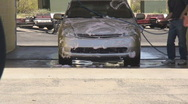 Stock Video Footage of At the manual car wash - 6 - soaping up the car with soap brush power