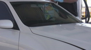 Windshield repair or replacement - 8 - cutting out old rummer seal Stock Footage