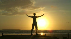Woman doing relaxation exercises at sunrise Stock Footage