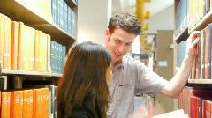 Students Interacting in Library Aisle Stock Footage