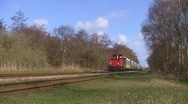 Stock Video Footage of Narrow gauge train passing by