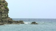 Stock Video Footage of sailboat heading to sea beyond rocks