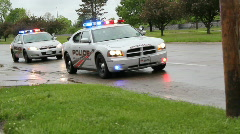 Police cars with flashing emergency lights Stock Footage